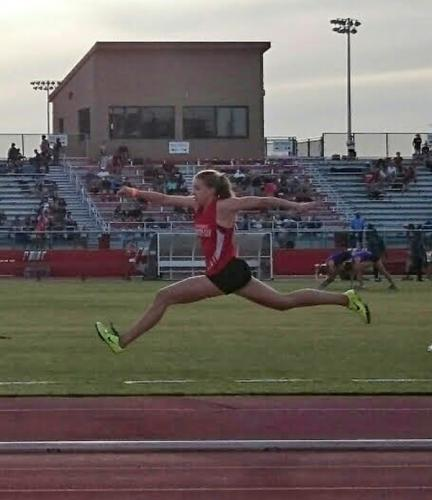 Image of Freshman Heidi Johnson wins the Section Championship with a triple jump of 35′11.25″.