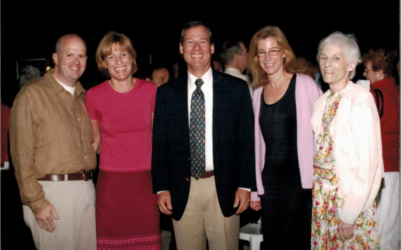 Francie Tidey (far right) with headmaster Steve Repsher and members of her family at a graduation ceremony.
